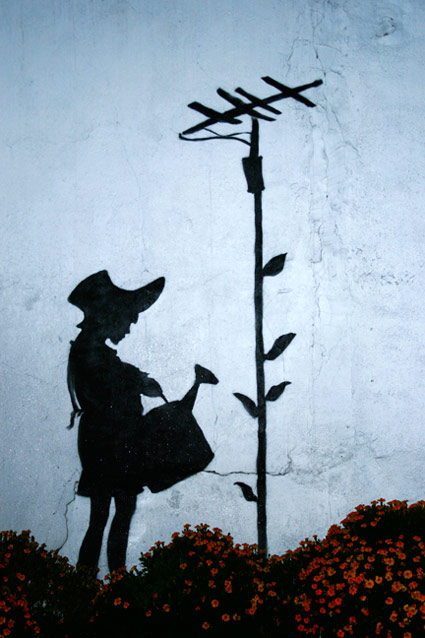 Banksy - Girl Watering Telephone Pole